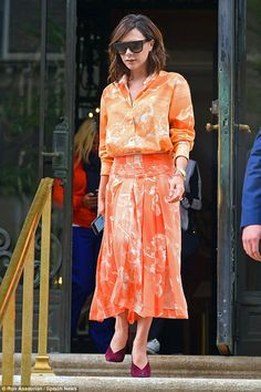Victoria Beckham is a dream in tangerine in New York City | Daily Mail Online