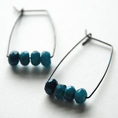 sterling silver earrings feature faceted rondelles of blue jade