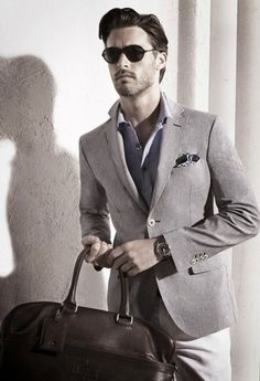 MM SAYS: He looks sharp because his blazer fits beautifully. Analyze where all the edges hit. His upscale casual shirt unbuttoned looks even cooler with that unassuming pocket square. A stylish upscale casual look that I'd look twice at!