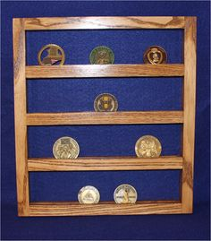 """This item is made of hickory wood, it is stained dark mahogany and clear coated with a clear satin finish. Holds 20 military unit coins based on a 2"""" coin, has blue felt and comes with hardware to hang it with.  Item is 13"""" tall,  11 13/16"""" wide and 1"""" thick.  COINS NOT INCLUDED."""