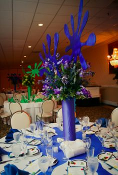 """These Bar Mitzvah centerpieces included blue """"splats"""" to match the paintball theme! 
