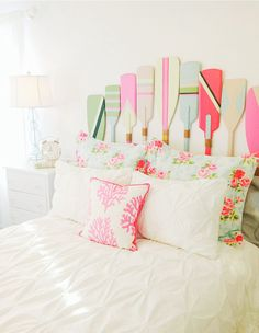 Colorful painted Paddles turned into a bed headboard....