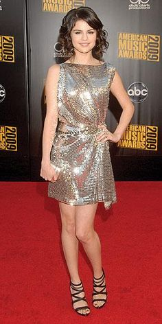 Who made Selena Gomez's gold dress that she wore to the 2009 American Music Awards? Dress – Talbot Runhof