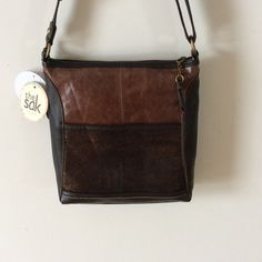 Brown leather Sak bag. NWT Very cool brown, bronze  and black leather bag.   Open and zippered pocket outside.  Adjustable shoulder strap.  2/10/12 The Sak Bags Crossbody Bags
