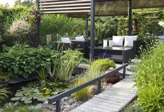Make the most out of a small garden space with these ideas and inspirations, including abundant borders, patio fruit trees, and outdoor living spaces. Small Space Gardening, Garden Spaces, Small Gardens, Garden Beds, Outdoor Gardens, Outdoor Landscaping, Front Yard Landscaping, Patio Design, Garden Design