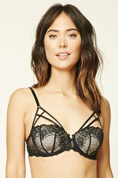 A lightly padded lace bra with a strappy caged front, adjustable cami straps, and a triple hook-eye back closure.