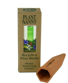 Plant Nanny! Water your plants while you're away! Just add an empty wine bottle filled with water ! Buy them at The Picture Show, Fairhope (251) 928-9931