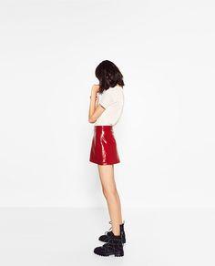 Image 4 of MINI PATENT FINISH SKIRT from Zara