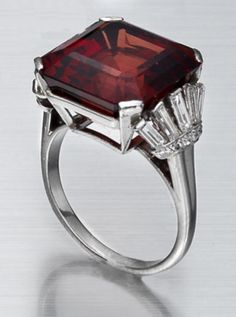 An art deco spinel and diamond ring, circa 1935  The square-cut spinel, weighing 18.70 carats, to fan-shaped shoulders set with baguette and single-cut diamonds