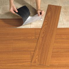 vinyl plank flooring ~ perfect for camper flooring, great idea and it goes right over the existing flooring...