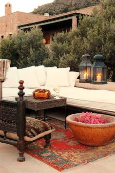 Moroccan outdoor decor. Everything is sitting on a beautiful vintage rug. #Handmade #Vintage #Decor