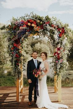 Loving this beautiful floral arch as a backdrop for your wedding ceremony with a rich colour palette of reds with greenery and splash of white! See more of this modern wedding on Aisle Society! Floral Wedding Decorations, Wedding Colors, Wedding Flowers, Church Decorations, Wedding Backdrops, Flower Centerpieces, Purple Wedding, Spring Wedding, Wedding Centerpieces