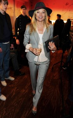 Pin for Later: 41 Reasons Why Kate Moss Is a Total Fashion Force 12. She Understands the Power of a Hat A menswear-inspired look was Kate's choice for the James Small show at London Fashion Week. A fedora topped her slimline grey trouser suit.
