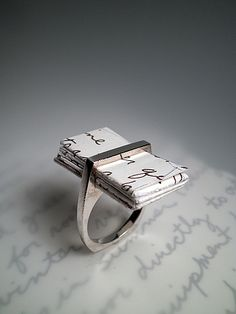 "conflictingheart:    Love letter ring - buy it here    The ""I (THOU) Ring"". Wonder if someone makes a ring blank like this out of base metal, because it would sell massively and the idea is so good!"