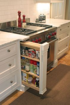 Hide your spice cabinet with this awesome feature. Use a decorative cabinet leg to frame your oven but also store your spices.