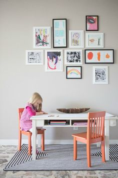 Incorporate kids art into your family gallery wall for fun pops of color! || http://www.designimprovised.com