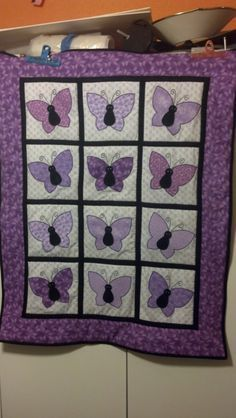 Love!  I love purple, love butterflies....  the little white eyes are adorable and make me smile to look at them.