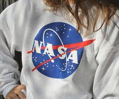 Show off your love for astronomy while you stay warm and cozy wearing this NASA logo sweatshirt. This crew style sweatshirt features a loose and comfy fit emblazoned with the iconic NASA logo across the front of it.