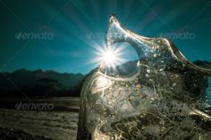 Realistic Graphic DOWNLOAD (.ai, .psd) :: http://jquery.re/pinterest-itmid-1007059557i.html ... Sunburst Through Ice ... <p>Ice chunk framing a sunburst on an Alaskan beach in winter with mountains in the distance.</p> alaska, beach, blue sky, cold, frozen, ice, mountains, nature, patterns, snow, sun, sunburst, sunny, winter  ... Realistic Photo Graphic Print Obejct Business Web Elements Illustration Design Templates ... DOWNLOAD :: http://jquery.re/pinterest-itmid-1007059557i.html