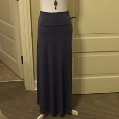 """Hiatus Denim Blue Color Maxi Skirt, Large Cute, Hiatus denim Blue color maxi skirt, large. It has slight ruching side panels at waist to hold you in and give it a flattering look. Very flattering figure material and so soft! Worn twice, excellent condition!! 40"""" long. You can fold the waist band down or keep it up! Goes with everything, every season! Dress it up or down! Hiatus Skirts Maxi"""