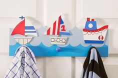 Ships Peg Rail  Pale blue children's peg rail from the Gisela Graham ships range, made of wood with three boat themed shapes on the top of it.  The three boat designs vary from tug to sailing boats and are all painted white, red and blue. Three blue hooks are attached for hanging dressing gowns etc. | Childrens Bed Centres