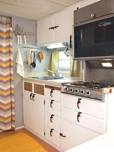Camper Interior Decorating Ideas - Unique RV Decorating Ideas - Country Living  Your RV is your #home away from home, may as well make it your own!  Buying an #RV gives you the freedom to travel wherever curiosity takes you. Visit RV's of America www.rvsofamerica.com