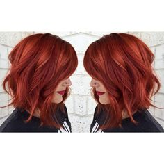 Hot copper red hair achieved from Aveda Color.