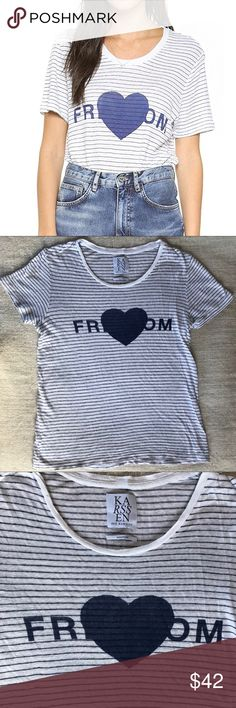 """Zoe Karssen Love Freedom Striped Short Sleeve Tee Zoe Karssen Love Freedom Striped Short Sleeve Tee. Size M. White with navy blue stripes and graphic. EUC. No damage/issues. Measurements are approximate: 22"""" across chest. 28"""" shoulder to hem. 8"""" sleeve length. Zoe Karssen Tops Tees - Short Sleeve"""