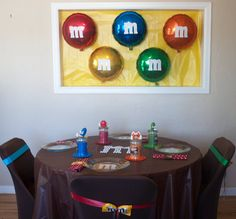 "Add an ""m"" to simple round foil balloons.  Could also use colored paper plates!"