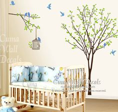 Tree, birds, and birdcage wall decals.