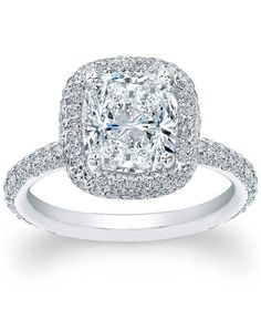 Thin Micro-pave Halo Diamond Engagement Ring by Since1910 // More from Since1910: http://www.theknot.com/gallery/wedding-rings/Since1910