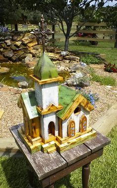 Bird house, rustic white washed church with steeple.