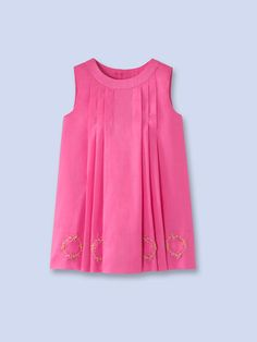 Pleat front dress with embroidered flowers at the base.