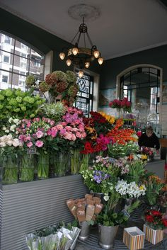 Bibendum Flower Shop, Fulham Road, London... Like the big clear vases instead of buckets!
