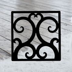 This decorative Wrought Iron Wall Art piece, Style 208,  features a Geometric square silhouette that will add beauty and character to any wall or surface. It is coated in one of the most long-lasting finishes available - a flat black baked-on powder coated finish that will last for many years. Wrought Iron Wall Art, Art Pieces, Powder, Surface, Wall Decor, Silhouette, Flat, Crafts, Character