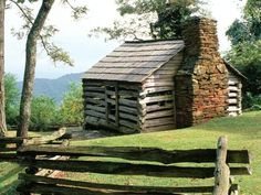 Beautiful old log cabin in the mountains. This looks like a view ftom the blue ridge parkway