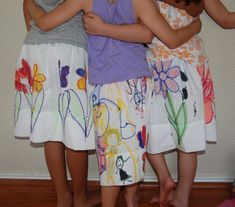 Pillowcase skirts! An activity for a slumber party. Decorated with Elmers permanent marks and acrylic paint and set with a wash in vinegar. Simple elastic waist with one hem. Not too hard and totally awesome.