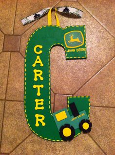 "John Deere. 13"" Initial art. Personalized Homemade Nursery decor Wall letters kids door signs birth info plaques crib mobiles canvas art family name door hangers by Billie Landers Bamland Designs Charleston WV PayPal accepted. Mailing available. Come LIKE my page on Facebook http://m.facebook.com/BamlandDesignsCustomNurseryWallLettersMore"