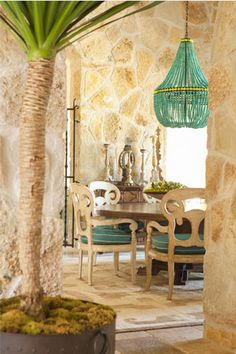 Turquoise chandelier & stone walls! Southern California interior design firm Bonesteel Trout Hall