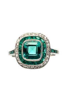 """Brides.com: . """"Breckenridge"""" 1.64ct cushion-cut emerald set in platinum surrounded by a halo of 18 calibre-cut emeralds and 30 rose cut diamonds, $25,000, Trumpet & Horn"""