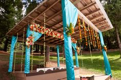 Indian Wedding Mandap in Satin Fabric and flowers in coral, white and green.