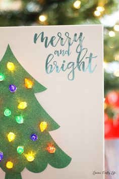 Lighted Christmas Tree Canvas. Create a festive, lighted display using the Cricut Explore Air 2 machine and the Design Space app.