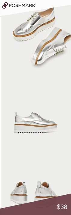 •Zara silver platform sneakers• Silver flat platform shoes. Topstitching around the welt in a contrasting colour. Back pull tab. Lace-up fastening.  Sole height 5 cm. / 1.9″ Zara Shoes Platforms