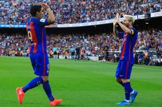 Barcelona's Argentinian forward Lionel Messi (R) celebrates after scoring with Barcelona's Uruguayan forward Luis Suarez during the Spanish league football match FC Barcelona vs Real Betis Balompie at the Camp Nou stadium in Barcelona on August 20, 2016. / AFP / PAU BARRENA