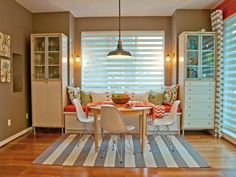 Designer Jil Sonia McDonald paired understated grays with vibrant patterns to create a dining room that is not only eclectic but inviting.