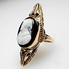 Sardonyx agate cameo cocktail ring from the Victorian Era set in an ornate diamond-shape gold setting.