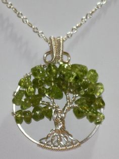 I want this!!!     Peridot Silver Tree of Life Wire Wrapped by Mariesinspiredwire, $25.00. http://www.etsy.com/shop/Mariesinspiredwire