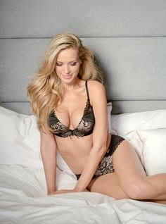 Ultimo Black Label OMG 'Vivian' is elegant and alluring, soft gold cups combined with contrasting black eyelash lace detail and satin to create a delicate, yet striking style - finished with shimmering straps, ribbon and gold branding.   The Vivian plunge bra features Ultimo's famous gel-technology to enhance the bust by 2-cup sizes, whilst also delivering extreme comfort and support.