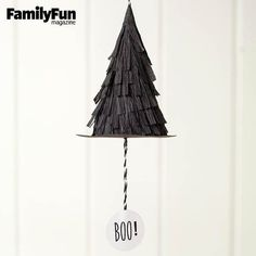 How adorable are these Witch Topper Party Poppers from FamilyFun Magazine?! Packing the punch of piñatas without the mess and tears, these spellbinding little hats spill goodies when the tags are pulled. Display them on hooks or a branch. When it's time to pop them, take each hat down, then hold the cone in one hand while pulling the string with the other. DIY HALLOWEEN WITCH HAT PARTY PINATA POPPERS