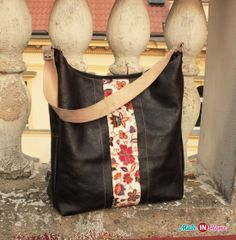 Simple, spacious leather handbag in dark brown color with beige strap. The entire bag is lined and closing the zipper. The bottom of the bag is widespread and strong.  Playfully seats up to A4 format Inside the bag are practical pockets for your small items.